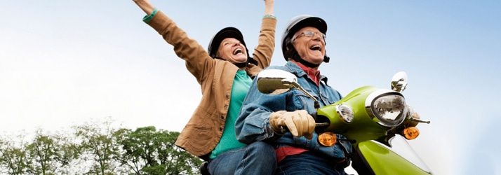 Happy Aging Couple on Moped